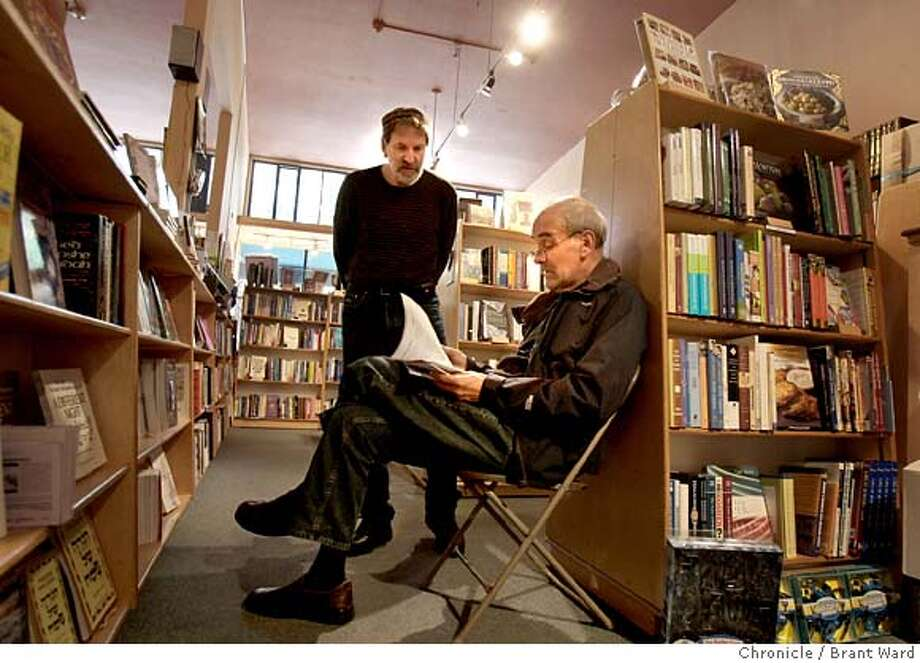 Bookstore owner Jerry Derblich, left, helped Bob Fox with his reading selection for Passover. For some Jews, the liturgy you choose at Passover says a lot about your religion and relationships with friends and family. At Afikomen bookstore on Claremont Avenue in Berkeley, Calif., this is a special time of year Wednesday, April 16, 2008. Photo by Brant Ward / San Francisco Chronicle  Ran on: 04-19-2008  At the Afikomen Judaica store in Berkeley, owner Jerry Derblich (left) helps Bob Fox select readings for Passover. Photo: Brant Ward