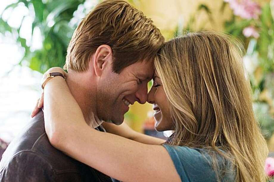 "In this film publicity image released by Universal Pictures, Aaron Eckhart, left, and Jennifer Aniston are shown in a scene from, ""Love Happens.""  (AP Photo/Universal Pictures, Kimberley French) Photo:  Kimberley French, AP"