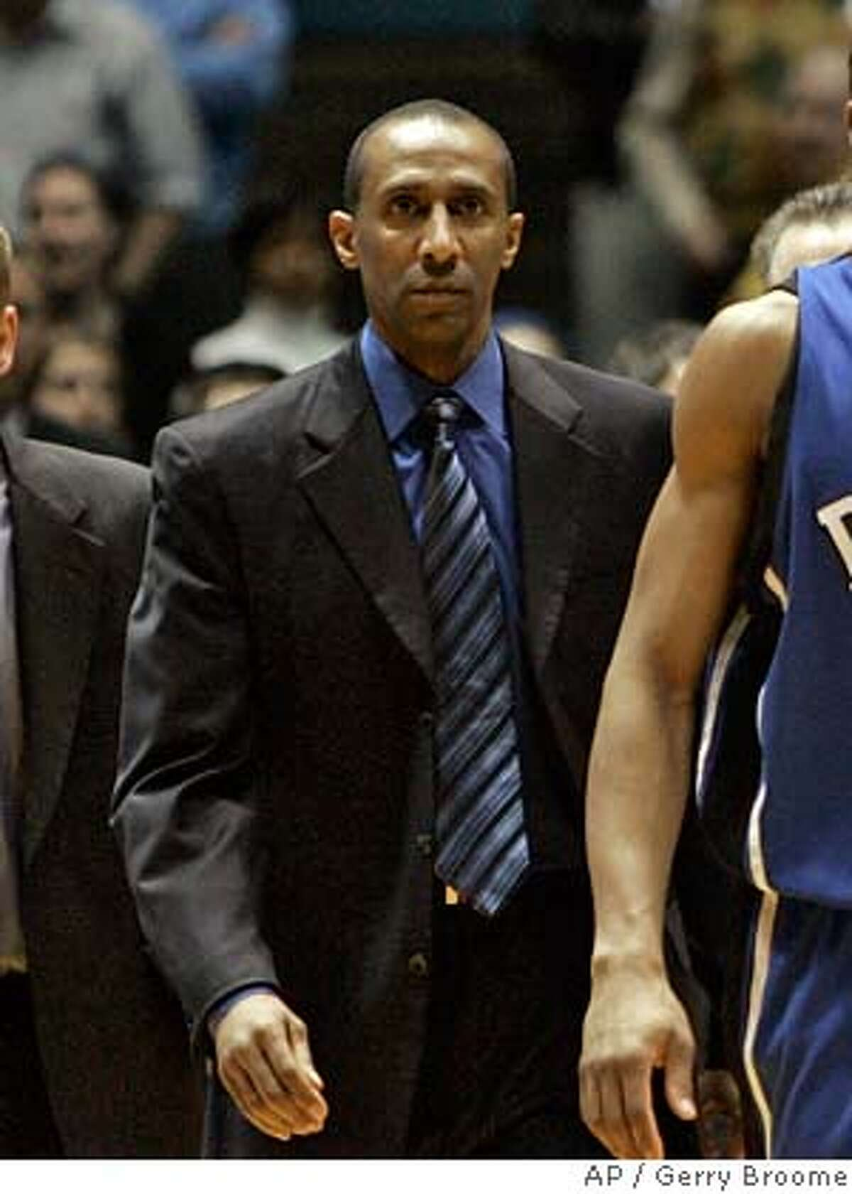 Duke's Gerald Henderson (15) leaves the court after being ejected for a flagrant foul on North Carolina's Tyler Hansbrough during the second half of a college basketball game in Chapel Hill, N.C., Sunday, March 4, 2007. North Carolina won, 86-72. From left are assistant coaches Steve Wojciechowski and Johnny Dawkins.(AP Photo/Gerry Broome)