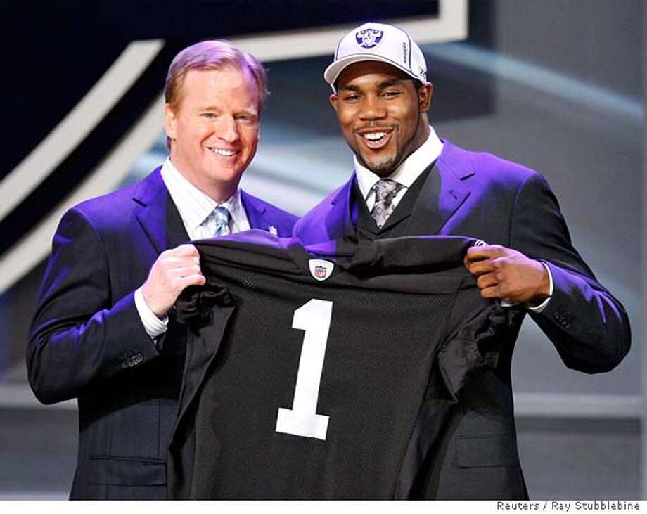 ###Live Caption:Darren McFadden, Arkansas running back, the fourth pick selected by the Oakland Raiders during the 2008 NFL Draft, poses with NFL Commissioner Roger Goodell in New York April 26, 2008. REUTERS/Ray Stubblebine (UNITED STATES)###Caption History:Darren McFadden, Arkansas running back, the fourth pick selected by the Oakland Raiders during the 2008 NFL Draft, poses with NFL Commissioner Roger Goodell in New York April 26, 2008. REUTERS/Ray Stubblebine (UNITED STATES)###Notes:McFadden, Arkansas running back, the fourth pick selected by the Oakland Raiders during the 2008 NFL Draft, poses with NFL Commissioner Goodell in New York###Special Instructions:0 Photo: RAY STUBBLEBINE