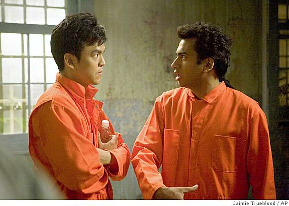 """In this image provided by New Line Cinema, John Cho, left, and Kal Penn, are shown in a scene from New Line Cinema's """"Harold and Kumar Escape from Guantanamo Bay"""".  (AP Photo/New Line Cinema, Jaimie Trueblood) ** NO SALES ** Photo: Jaimie Trueblood, AP"""