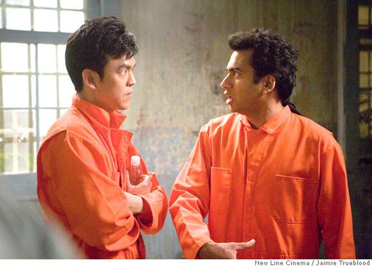 In this image provided by New Line Cinema, John Cho, left, and Kal Penn, are shown in a scene from New Line Cinema's