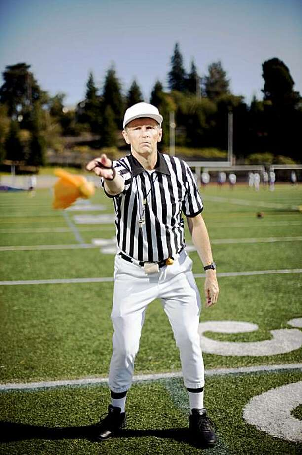 Mortgage broker and high school football referee Conrad Bassett stands for a portrait at Piedmont High School in Piedmont, Calif. on Monday, Aug. 24, 2009. Photo: Stephen Lam, The Chronicle