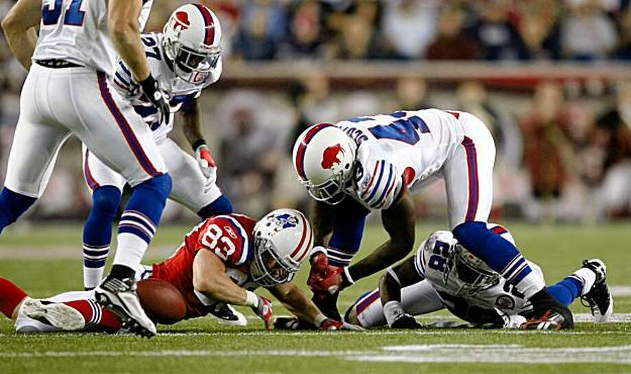 FOXBORO, MA - SEPTEMBER 14:  Wes Welker #83 of the New England Patriots reaches for a loose ball against Bryan Scott #43 and Leodis McKelvin #28 of the Buffalo Bills on September 14, 2009 at Gillette Stadium in Foxboro, Massachusetts. (Photo by Elsa/Getty Images) Photo: Elsa, Getty Images