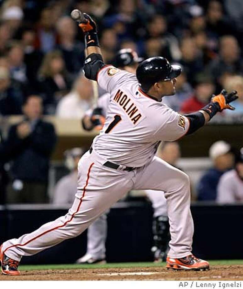 San Franciosco Giants' Bengie Molina watches his game tying solo home run in the ninth inning of a baseball game against the San Diego Padres Wednesday, April 23, 2008 in San Diego. (AP Photo/Lenny Ignelzi) Photo: Lenny Ignelzi