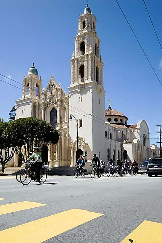 Mission History Ride participants cruise by Mission Dolores in San Francisco. Photo: Dustin Jensen