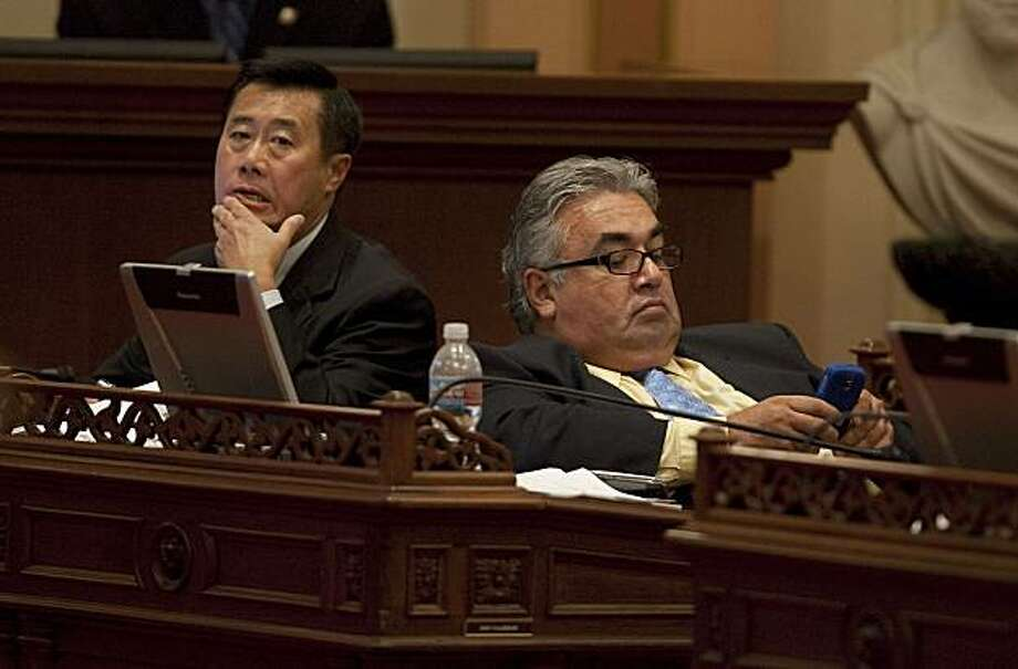 State Senators Leland Yee (D- San Francisco), left and Ronald Calderon (D-Montebello) right, listen to the debate on the budget bills in Sacramento, July 23, 2009. Photo: Robert Durell, Special To The Chronicle