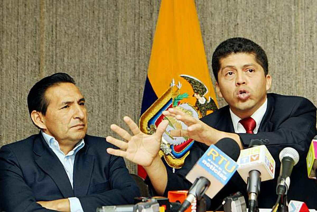 Lawyer Pablo Fajardo, right, who represents the Amazon Defense Coalition in a case against U.S. oil company Chevron for environmental damage alleged caused by Texaco in the Amazon rain forest before it left in the 1990s., speaks at a press conference in Quito, Thursday, Aug. 3, 2009. An Ecuadorian judge presiding over the billionaire environmental lawsuit said Wednesday that he was set up in videotapes, released by Chevron, that show him allegedly telling businessmen he's already made up his mind to rule against the company. At left is Luis Yanza, the president of the delegated of the Amazon Defense Coalition. (AP Photo/Dolores Ochoa)