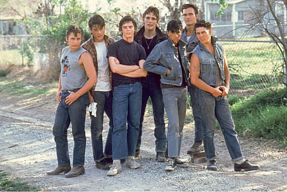 "In this 1983 file photo provided by Warner Bros., cast members from the 1983 film ""The Outsiders,"" from left, Emilio Estevez, Rob Lowe, C. Thomas Howell, Matt Dillon, Ralph Macchio, Patrick Swayze and Tom Cruise, are shown. Swayze's publicist Annett Wolf says the 57-year-old ""Dirty Dancing"" actor died Monday, Sept. 14, 2009, after a nearly two-year battle with pancreatic cancer. Photo: Anonymous, AP"