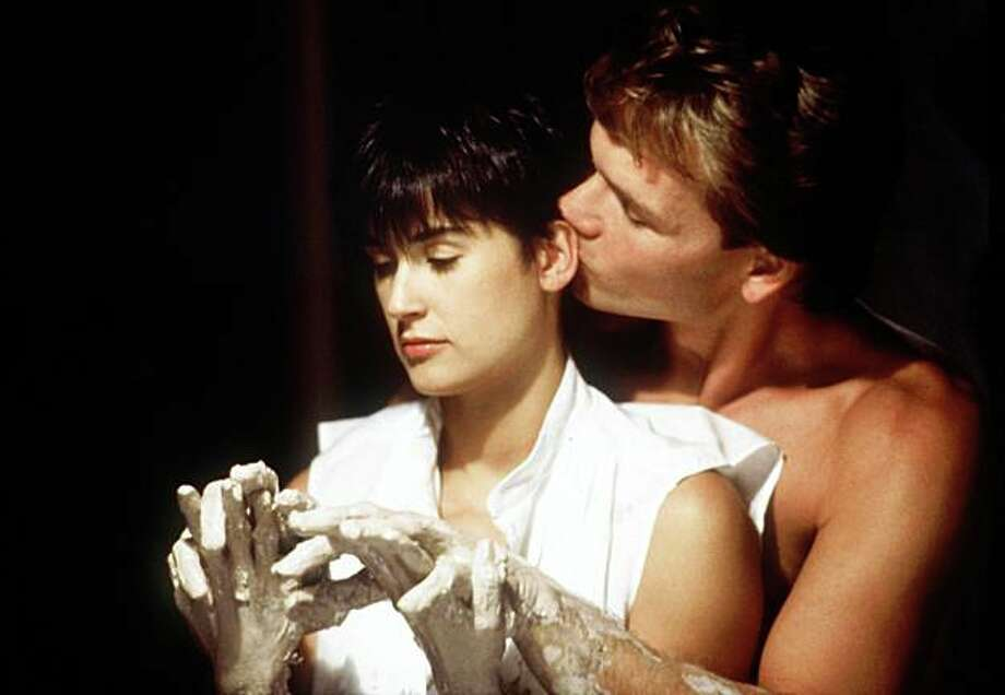 """In this image released by Paramount Pictures, Demi Moore, left, and Patrick Swayze are shown in a scene from """"Ghost.""""  Swayze's publicist Annett Wolf says the 57-year-old """"Dirty Dancing"""" actor died Monday, Sept. 14, 2009, after a nearly two-year battle with pancreatic cancer. Photo: Anonymous, AP"""