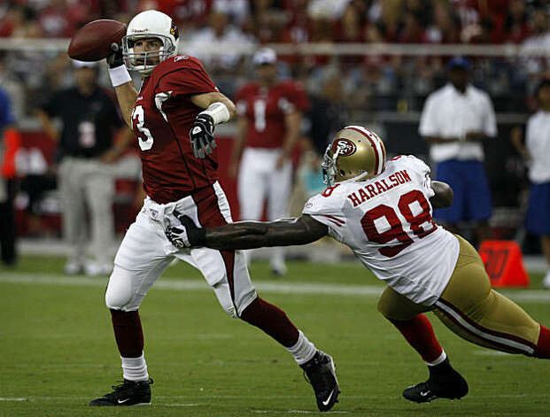 Parys Haralson grabs hold of quarterback Kurt Warner in the second quarter of the San Francisco 49ers vs. Arizona Cardinals NFL game in Glendale, Ariz., on Sunday, Sept. 13, 2009. Photo: Paul Chinn, The Chronicle