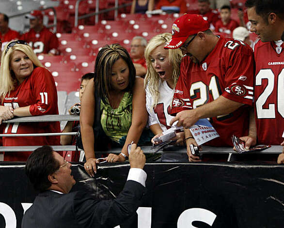 Team co-chairman John York greets 49ers fans before the San Francisco 49ers vs. Arizona Cardinals NFL game in Glendale, Ariz., on Sunday, Sept. 13, 2009. York handed out pins and a few lucky fans received pre-game field passes to watch the team warm-up. Photo: Paul Chinn, The Chronicle
