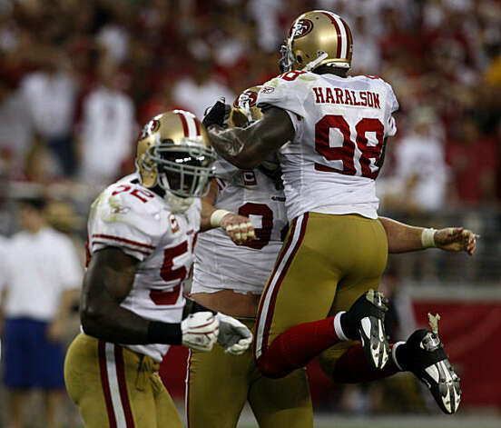 Parys Haralson jumps into the arms of Justin Smith after the defense sacked Kurt Warner on the final play of the San Francisco 49ers vs. Arizona Cardinals NFL game in Glendale, Ariz., on Sunday, Sept. 13, 2009. Photo: Paul Chinn, The Chronicle