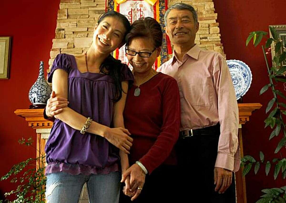 Ballerina Yuan Yuan Tan poses with her parents Su Zhang and KeQin Tan at their home, Thursday Sept. 3, 2009, in San Francisco, Calif.