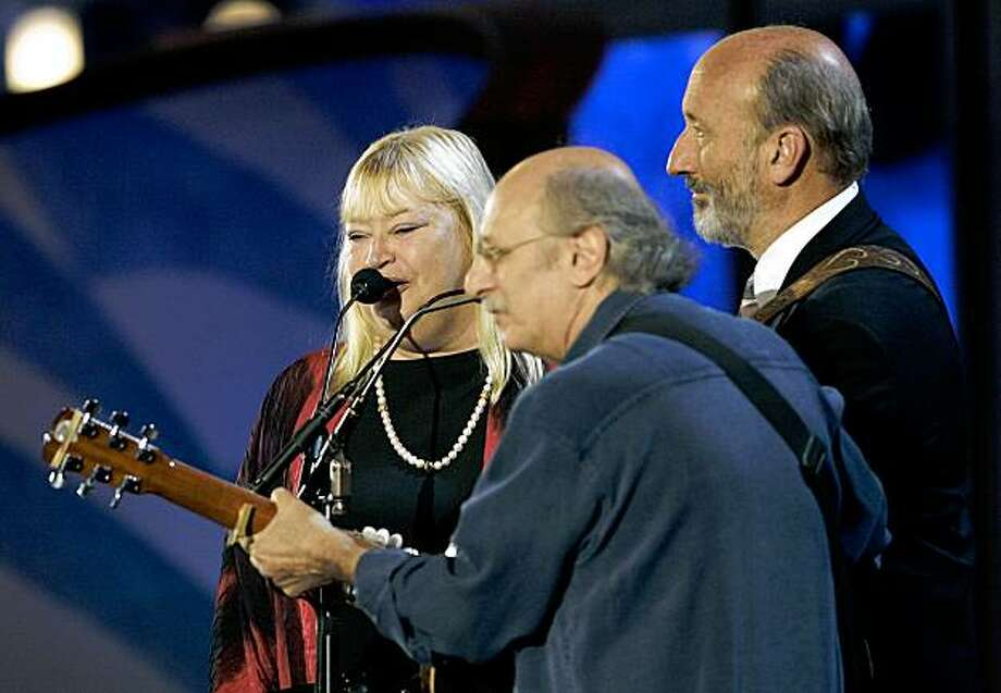 FILE - In this July 27, 2004 file photo,  Mary Travers,  Peter Yarrow and Paul Stookey. of Peter, Paul and Mary perform before the delegates during the Democratic National Convention in Boston. Travers, who had battled leukemia for several years, died Wednesday Sept. 16, 2009. She was 62. (AP Photo/Elise Amendola, File) Photo: Elise Amendola, File, AP