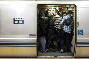 People try to get on BART at the Powell station early Sunday morning September 6, 2009 in San Francisco, Calif. Photograph by David Paul Morris / Special to the Chronicle