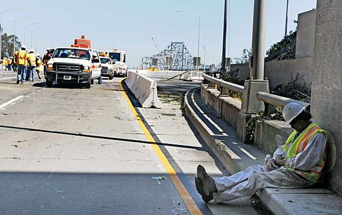 A California Transportation Department workers take a break from the long hours of work required to complete the seismic transformation of the Bay Bridge Sept 7, 2009.