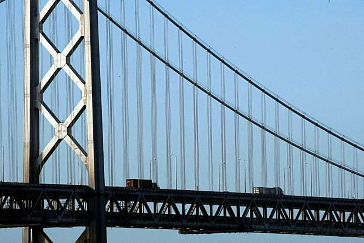 Commuters cross the western span of the Bay Bridge early Tuesday.