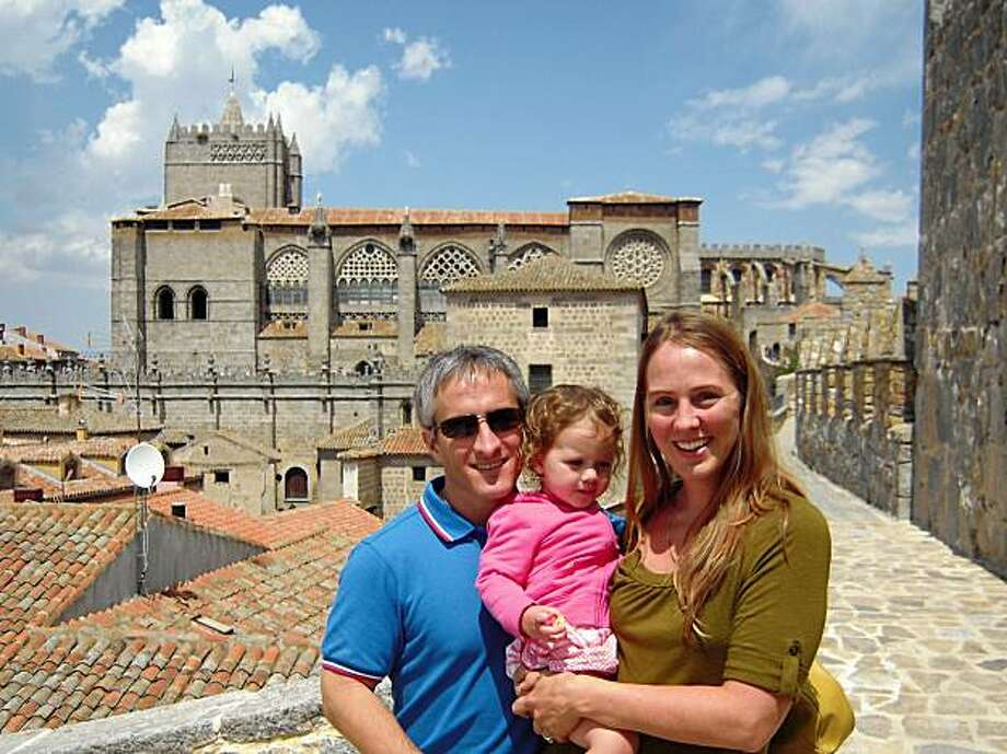 Daniel, Celeste and April Dávila of Los Angeles on the wall that surrounds the town of Ávila, with the Ávila Cathedral in the background. Photo: NA
