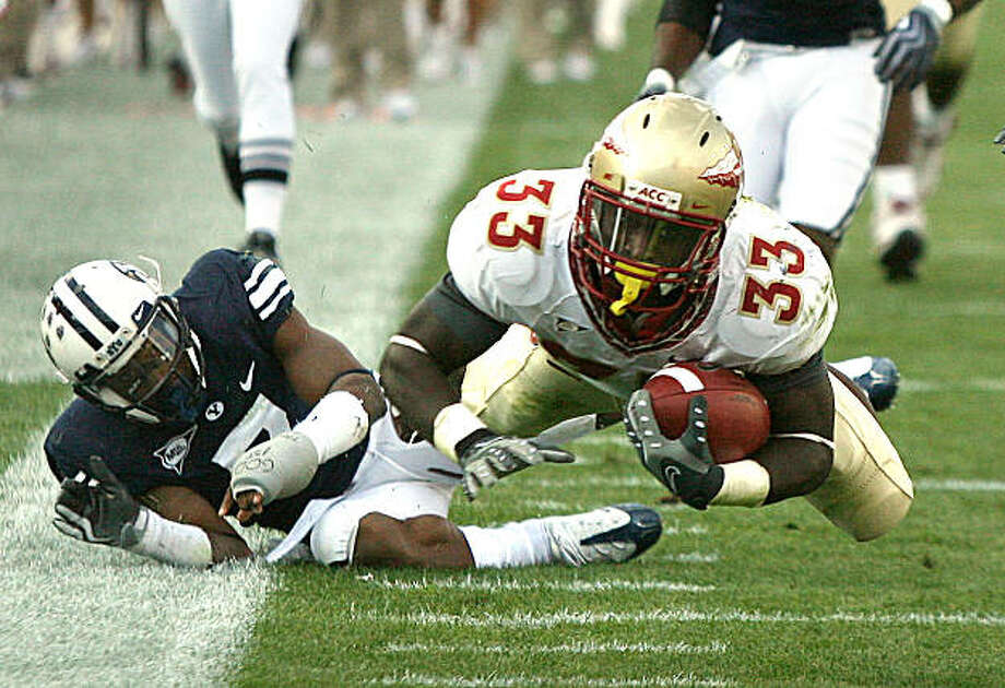 Florida State running back Ty Jones leaps for extra yardage  against BYU during an NCAA football game  in Provo, Utah, on Saturday, Sept. 19, 2009. AP Photo/Orlando Sentine, Stephen M. Dowell) ** LEESBURG OUT, LADY LAKE OUT, TV OUT, MAGS OUT, NO SALES ** Photo: Stephen M. Dowell, AP