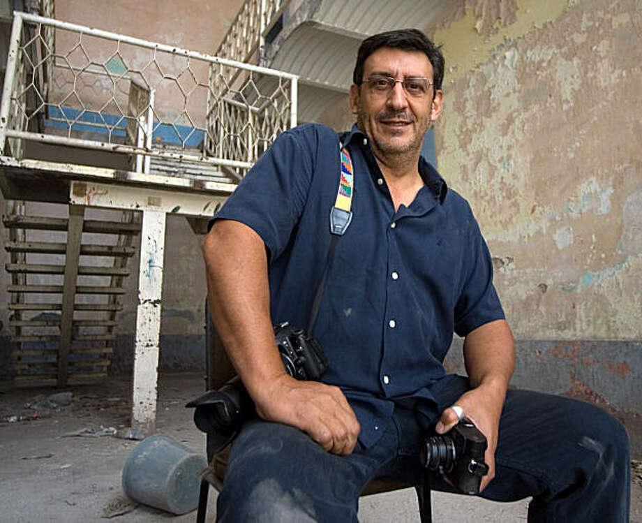 """Picture of Franco-Spanish director and photojournalist Christian Poveda, taken on August 29, 2009 in San Luis Potosi, Mexico where he was attending a workshop. Poveda was brutally murdered in El Salvador, weeks before the release of his latest documentary on the violent drug-running gangs that blight the country. He was found dead near his vehicle on a road north of the capital San Salvador on September 2, with what an autopsy later confirmed were four bullet wounds to the face, police and doctors said. He had been filming in La Campanera, a suburb of El Salvador's capital where gangs known as """"maras"""" pervade.  AFP PHOTO/Demian Chavez (Photo credit should read Demian CHAVEZ/AFP/Getty Images) Photo: DEMIAN CHAVEZ, AFP/Getty Images"""