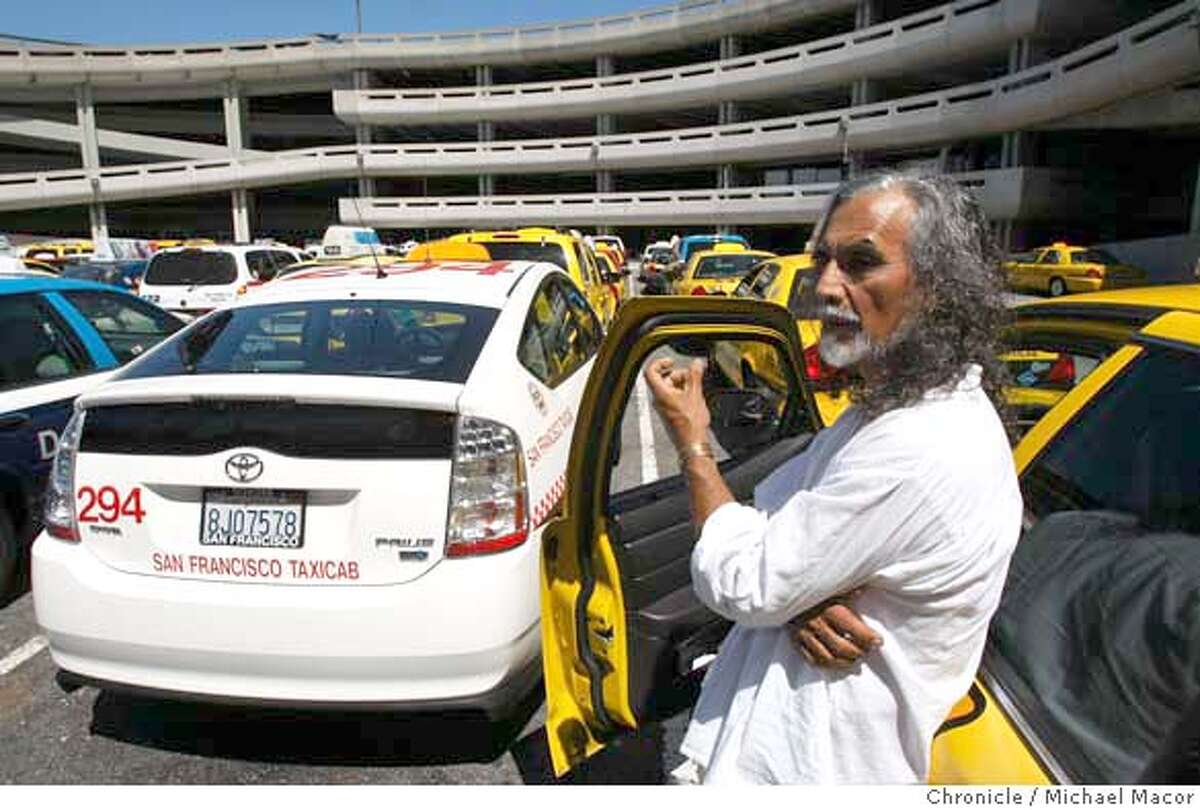 Jorge Perez, has been driving a taxi in San Francisco, Calif., for 28 years, he currently drives a full size Ford vehicle which cuts into his daily profits. Many drivers are moving to the Toyota Prius like the one on the left, to conserve full and save money. Perez waits in the dispatch lot along with dozens of other drivers to be release to pick up fares at San Francisco International Airport, on April 17, 2008. Photo by Michael Macor/ San Francisco Chronicle Ran on: 04-18-2008 Taxi driver Jorge Perez at San Francisco International Airport. Some colleagues have switched to a Prius.
