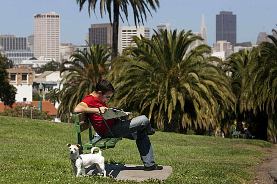 Jean Broccard and his dog Prince, a 9 month old Chihuahua mix, enjoy the warm weather at Delores Park September 4, 2009 in San Francisco, Calif. Photograph by David Paul Morris / Special to the Chronicle Photo: David Paul Morris, The Chronicle