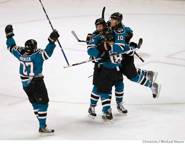 San Jose Joe Thornton is swarmed by teammates, San Jose Christian Ehrhoff, right and San Jose Matt Carle as well as San Jose Jeremy Roenick close by. after his first period goal,as the San Jose take on the Calgary Flames in game seven of the quarfter final series, on April 22, 2008, in San JOse, Calif. at the Oracle Arena. Photo by Michael Macor/ San Francisco Chronicle Photo: Michael Macor
