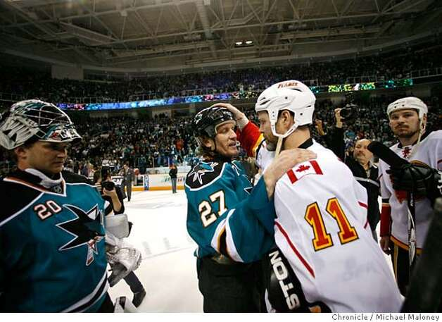 ###Live Caption:San Jose Sharks Jeremy Roenick (center) consoles Calgary Flames Owen Nolan (right) after the game. San Jose Sharks goalie Evgeni Nabokov is at left.  The San Jose Sharks host the Calgary Flames for game 7 of the NHL Western Conference Quarterfinals on April 22, 2008 at the HP Pavilion in San Jose, Calif. The Sharks won 5-3.  Photo by Michael Maloney / San Francisco Chronicle###Caption History:San Jose Sharks Jeremy Roenick (center) consoles Calgary Flames Owen Nolan (right) after the game. San Jose Sharks goalie Evgeni Nabokov is at left.  The San Jose Sharks host the Calgary Flames for game 7 of the NHL Western Conference Quarterfinals on April 22, 2008 at the HP Pavilion in San Jose, Calif. The Sharks won 5-3.  Photo by Michael Maloney / San Francisco Chronicle###Notes:***roster###Special Instructions:MANDATORY CREDIT FOR PHOTOG AND SAN FRANCISCO CHRONICLE/NO SALES-MAGS OUT Photo: Michael Maloney