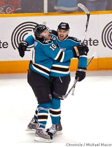 San Jose Christian Ehrhoff, left celebrates his teammates goal in the second period by San Jose Devin Setoguchi to make it 5-2 San Jose, as the San Jose take on the Calgary Flames in game seven of the quarfter final series, on April 22, 2008, in San Jose, Calif. at the Oracle Arena. Photo by Michael Macor/ San Francisco Chronicle Photo: Michael Macor