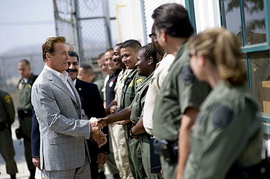 California Governor Arnold Schwarzenegger shakes hands with prison guards at the California Institution for Men prison on August 19, 2009 in Chino, California. After touring the prison where a riot took place on August 8th, Schwarzenegger said that the prison system is collapsing and needs to be reformed.  (Photo by Michal Czerwonka/Getty Images) Photo: Michal Czerwonka, Getty Images