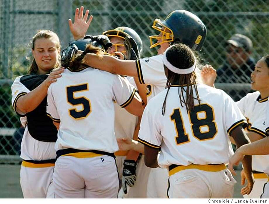 ###Live Caption:Notre Dame High school Plyssa Jepsen is greeted at home plate by her team after hitting her second homer of the day as Notre Dame defeated Presentation High School 8-5 Thursday April 24, 2008 in Belmont Calif, Photo By Lance Iversen / San Francisco Chronicle###Caption History:Notre Dame High school Plyssa Jepsen is greeted at home plate by her team after hitting her second homer of the day as Notre Dame defeated Presentation High School 8-5 Thursday April 24, 2008 in Belmont Calif, Photo By Lance Iversen / San Francisco Chronicle###Notes:Lance Iversen 415-2979395  CQ###Special Instructions:MANDATORY CREDIT PHOTOG AND SAN FRANCISCO CHRONICLE. Photo: LANCE IVERSEN