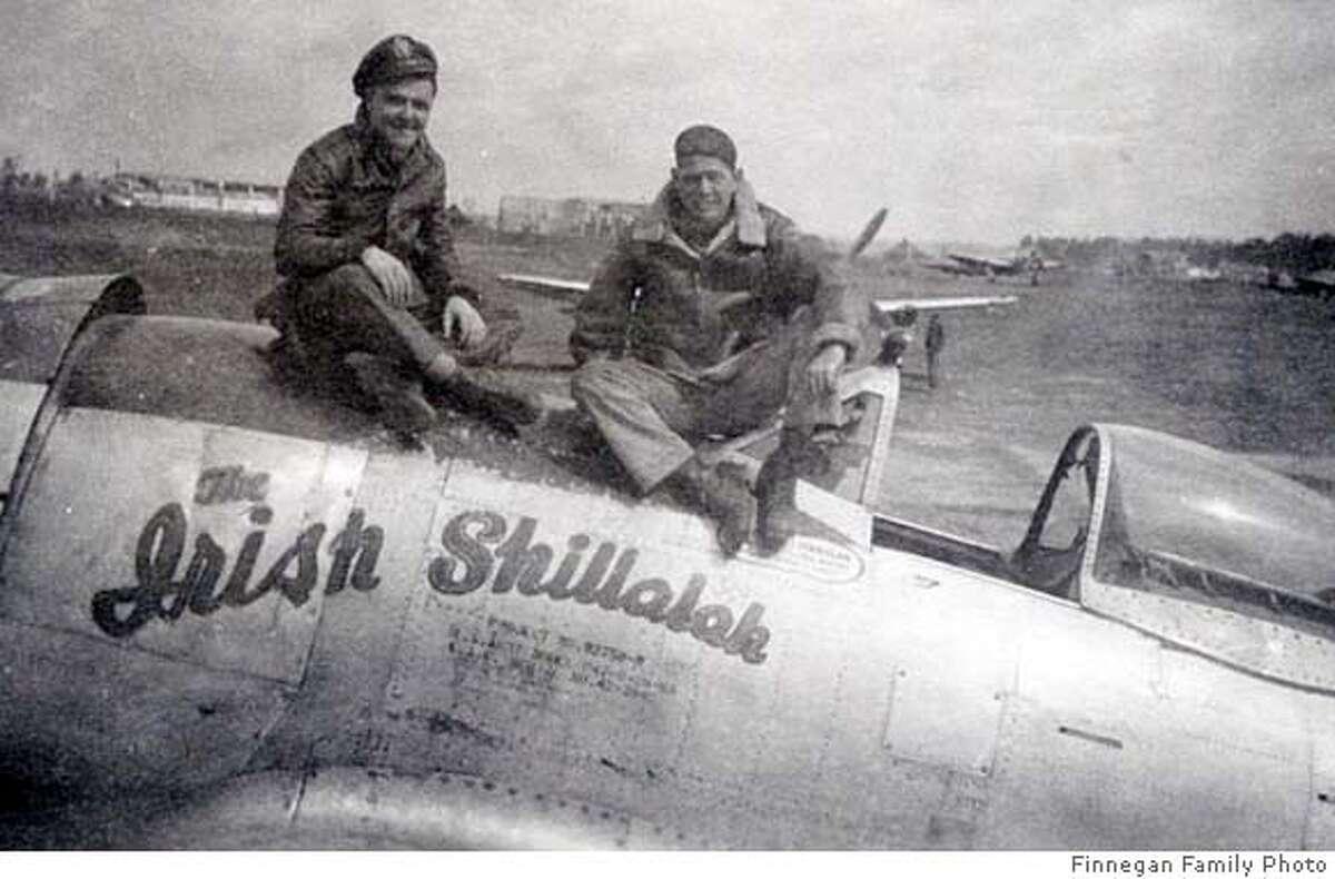 ###Live Caption:obit photo of James Finnegan (left), taken in May 1945, with his Crew Chief, Ben Massey atop Finnegan's P-47, nicknamed,