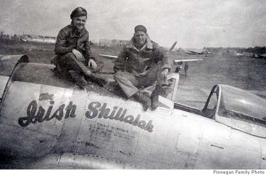 "###Live Caption:obit photo of James Finnegan (left), taken in May 1945, with his Crew Chief, Ben Massey atop Finnegan's P-47, nicknamed, ""The Irish Shillalah.""###Caption History:obit photo of James Finnegan (left), taken in May 1945, with his Crew Chief, Ben Massey atop Finnegan�s P-47, nicknamed, �The Irish Shillalah.�###Notes:###Special Instructions: Photo: Family Photo"