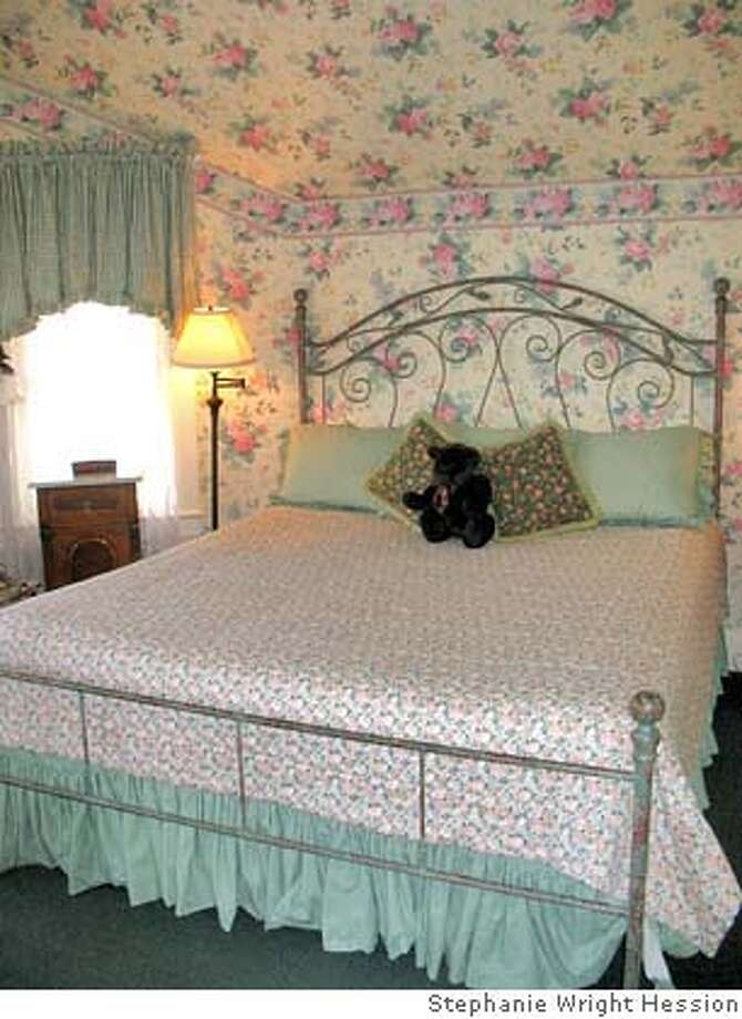 Floral motifs on wallpaper and bed linens are part of the quaint Victorian ambience of the Gosby House Inn in Pacific Grove. Photo: Stephanie Wright Hession