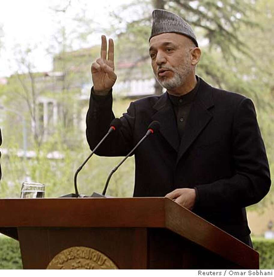 Afghan president Hamid Karzai (R) gestures next to European Union's foreign policy chief Javier Solana during a news conference in Kabul April 21, 2008. Poor security and the lack of good governance are the biggest challenges facing Afghanistan, European Union foreign policy chief Javier Solana said on Monday.REUTERS/Omar Sobhani (AFGHANISTAN)  Ran on: 04-26-2008  Afghan President Hamid Karzai says his government needs to be in charge of policy issues. Photo: OMAR SOBHANI