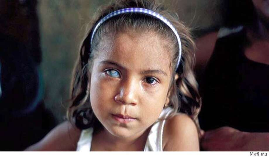 Pamela Ramirez, sitting at home in San Carlos, Ecuador. Photo: Mofilms