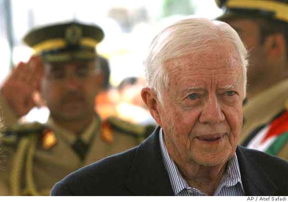 ###Live Caption:Former U.S. President Jimmy Carter is seen at the grave of late Palestinian leader Yasser Arafat's grave in the West Bank city of Ramallah, Tuesday, April 15, 2008. Former U.S. President Jimmy Carter said he will meet with a Hamas leader in the West Bank. The move signals he has not been cowed by criticism of his plans to meet with the violently anti-Israel group during his Mideast visit. (AP Photo/Atef Safadi, Pool)###Caption History:Former U.S. President Jimmy Carter is seen at the grave of late Palestinian leader Yasser Arafat's grave in the West Bank city of Ramallah, Tuesday, April 15, 2008. Former U.S. President Jimmy Carter said he will meet with a Hamas leader in the West Bank. The move signals he has not been cowed by criticism of his plans to meet with the violently anti-Israel group during his Mideast visit. (AP Photo/Atef Safadi, Pool)###Notes:Jimmy Carter###Special Instructions:POOL PHOTO Photo: ATEF SAFADI