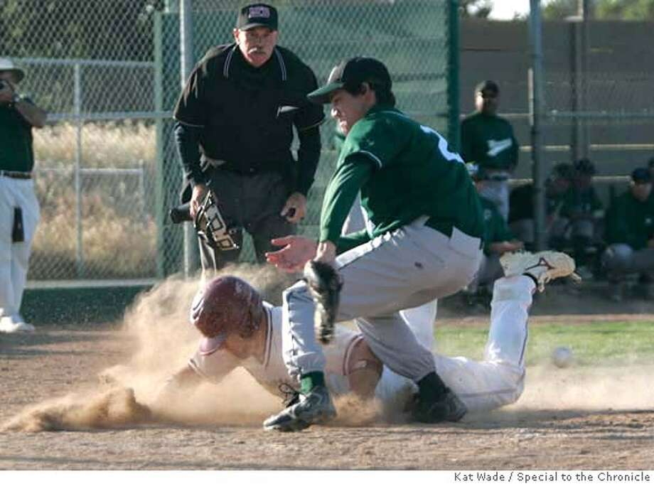 ###Live Caption:With umpire Dave Tooley keeping a close eye, Broncos catcher, Blaine Johnson, left, slides home past Matadors Tommy Miers to score the tenth run when Northgate Broncos beats the Miramonte Matadors 11 to 6 at Northgate in Walnut Creek, Calif. on Tuesday, April 15, 2008.  Photo by Kat Wade / Special to the Chronicle###Caption History:With umpire Dave Tooley keeping a close eye, Broncos catcher, Blaine Johnson, left, slides home past Matadors Tommy Miers to score the tenth run when Northgate Broncos beats the Miramonte Matadors 11 to 6 at Northgate in Walnut Creek, Calif. on Tuesday, April 15, 2008.  Photo by Kat Wade / Special to the Chronicle###Notes:###Special Instructions:Mandatory Credit for photographer and S.F. CHRONICLE/No Sales - mags out Photo: Kat Wade