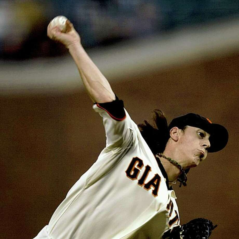 Tim Lincecum (55) of the San Francisco Giants delivers a pitch against the visiting Colorado Rockies at AT&T Park in San Francisco, Calif. on Monday, Sept. 14, 2009. Photo: Stephen Lam, The Chronicle