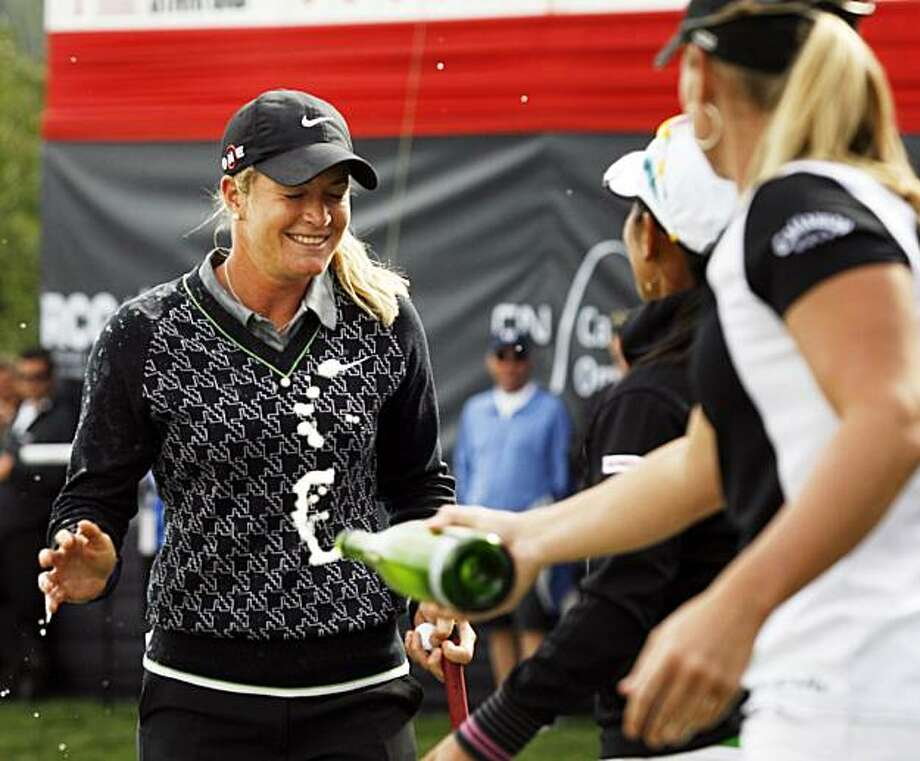 Norway's Suzann Pettersen, left, gets sprayed with champagne after winning the LPGA Canadian Women's Open golf tournament at 15-under par in Priddis, Alberta, Sunday, Sept. 6, 2009. (AP Photo/The Canadian Press, Jeff McIntosh) Photo: Jeff McIntosh, AP
