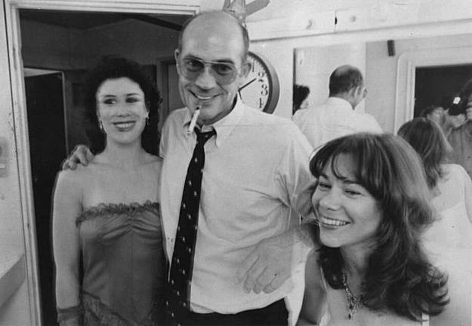 A Mitchell Brothers dancer, Hunter S. Thompson and author Simone Corday, taken in the mid-80s Photo: Michael Nichols
