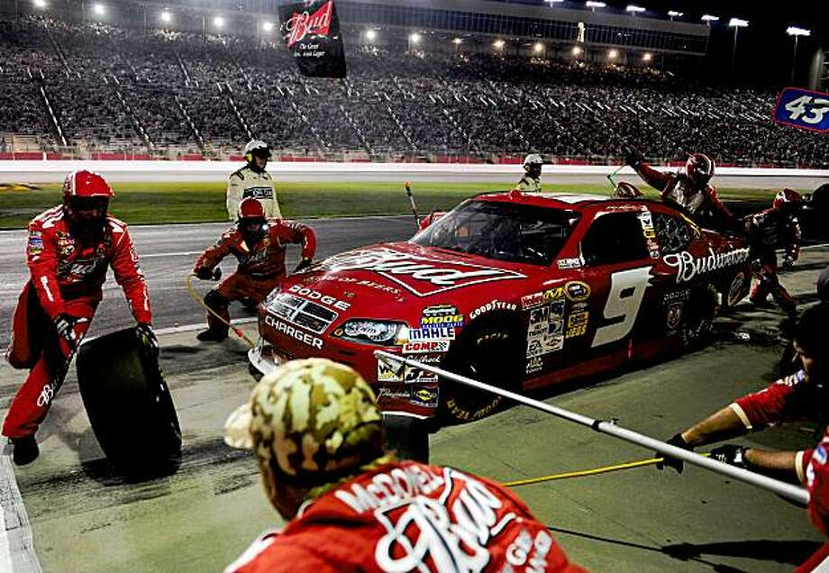 HAMPTON, GA - SEPTEMBER 06:  Kasey Kahne, driver of the #9 Budweiser Dodge, makes a pit stop during the NASCAR Sprint Cup Series Pep Boys Auto 500 at Atlanta Motor Speedway on September 6, 2009 in Hampton, Georgia.  (Photo by Rusty Jarrett/Getty Images for NASCAR) Photo: Rusty Jarrett, Getty Images For NASCAR