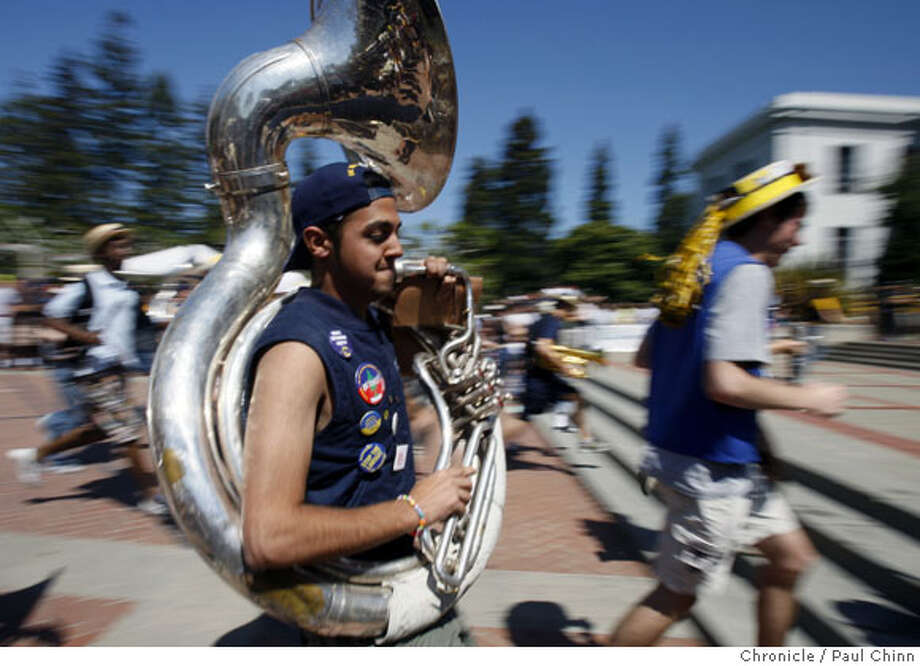 Cal marching band members race towards the steps of Sproul Hall for a lunchtime performance for the Cal Day open house at UC Berkeley on Saturday, April 12, 2008.  Photo by Paul Chinn / San Francisco Chronicle Photo: Paul Chinn