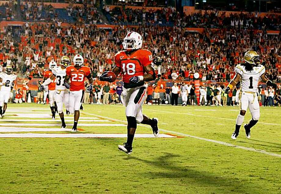 FORT LAUDERDALE, FL - SEPTEMBER 17:  Tight end Dedrick Epps #18 of the Miami Hurricanes breaks away for a touchdown against the Georgia Tech Yellow Jackets at Land Shark Stadium on September 17, 2009 in Fort Lauderdale, Florida.  (Photo by Doug Benc/Getty Images) Photo: Doug Benc, Getty Images