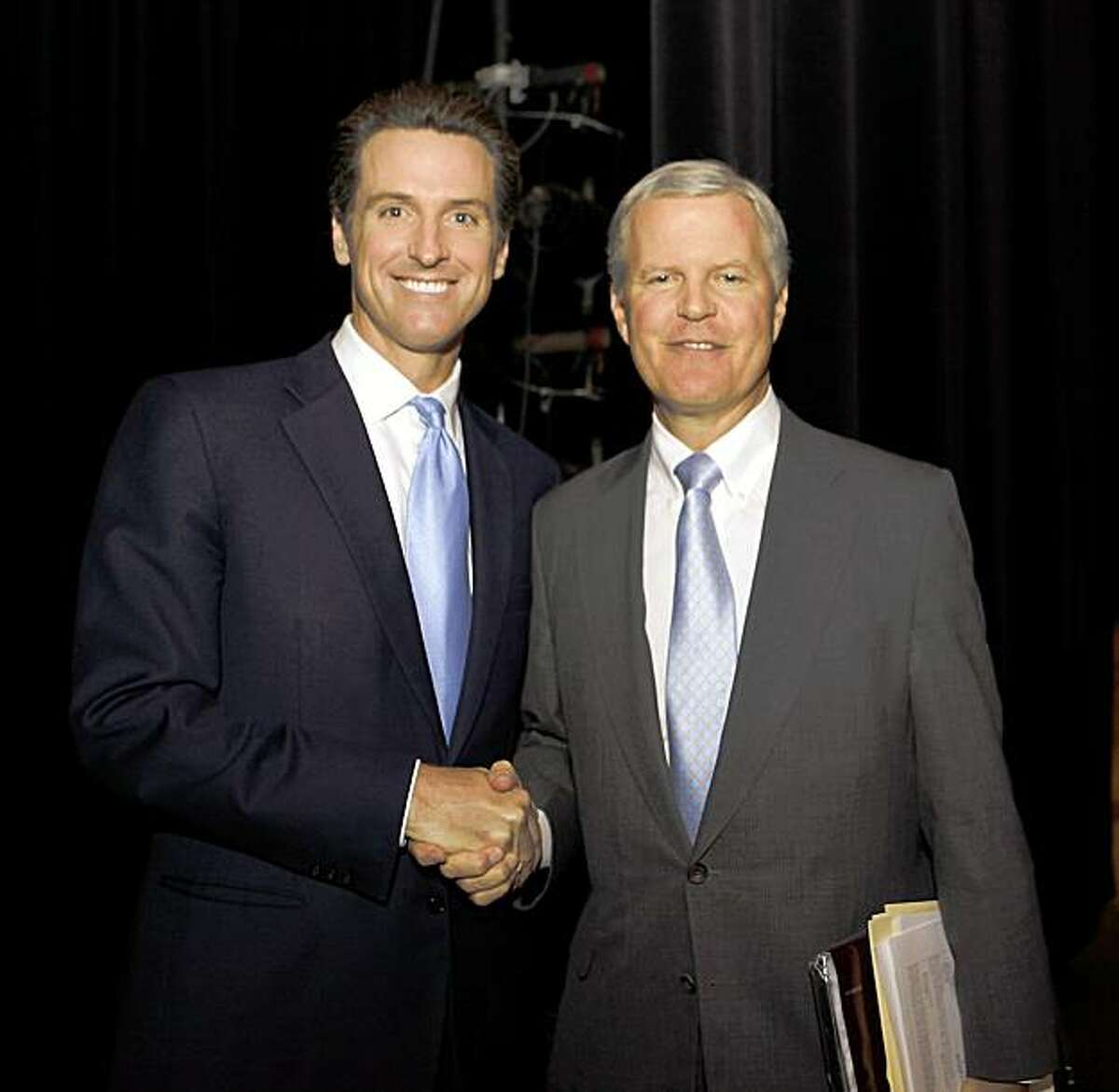 California Finance Director Tom Campbell, right, who is running for Governor, shake hands with San Francisco Mayor Gavin Newsom, left, who is also running for Governor, backstage between panel discussions at Santa Clara University in Santa Clara, Calif., Wednesday, Sept. 16, 2009. (AP Photo/Paul Sakuma)