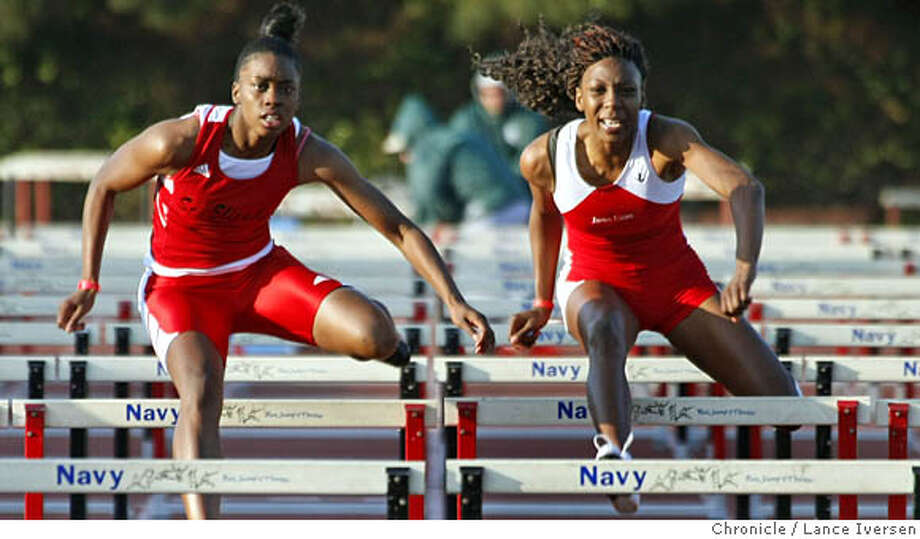 """Julian Purvis from St. Elizabeth High School left takes 1st place in the Women's 100 meter Hurdles Saturday night over 3rd place winner Brianna Stewart from James Logan High during the, James Logan 18th annual Top """"8"""" Track and Field Invitational. Photographed in Union City Calif, Saturday April 19, 2008. Photo By Lance Iversen / San Francisco Chronicle Ran on: 04-20-2008  Julian Purvis of St. Elizabeth-Oakland (left) works her way into first place in the girls 100-meter hurdles in Union City.  Ran on: 04-20-2008 Ran on: 04-20-2008  Julian Purvis of St. Elizabeth-Oakland (left) works her way into first place in the girls 100-meter hurdles in Union City. Photo: LANCE IVERSEN"""