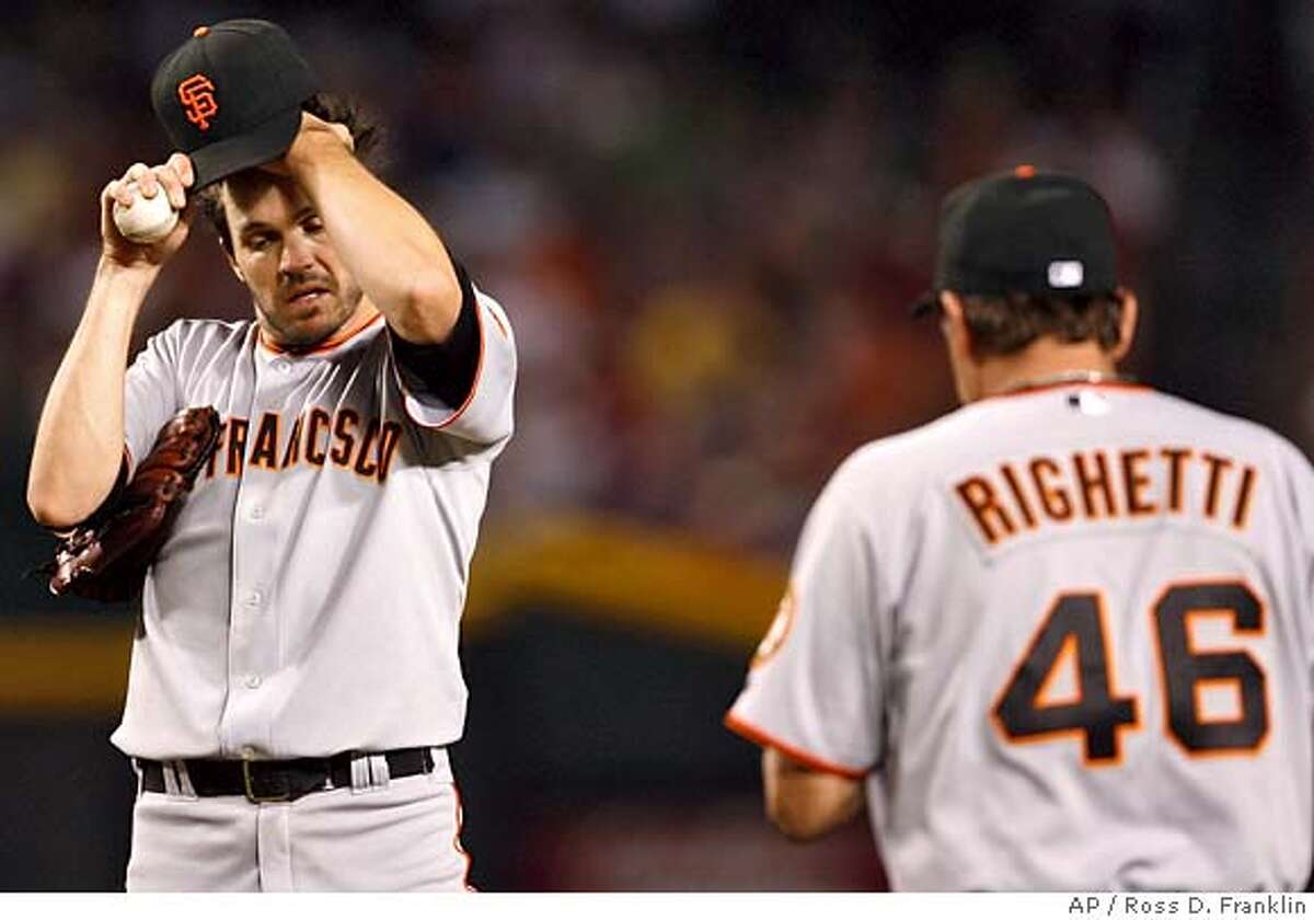 ###Live Caption:San Francisco Giants' Barry Zito, left, adjusts his hat as pitching coach Dave Righetti comes to the mound after Zito had given up two runs to the Arizona Diamondbacks in the fourth inning of a baseball game Tuesday, April 22, 2008, in Phoenix. (AP Photo/Ross D. Franklin)###Caption History:San Francisco Giants' Barry Zito, left, adjusts his hat as pitching coach Dave Righetti comes to the mound after Zito had given up two runs to the Arizona Diamondbacks in the fourth inning of a baseball game Tuesday, April 22, 2008, in Phoenix. (AP Photo/Ross D. Franklin)###Notes:Barry Zito, Dave Righetti###Special Instructions:EFE OUT