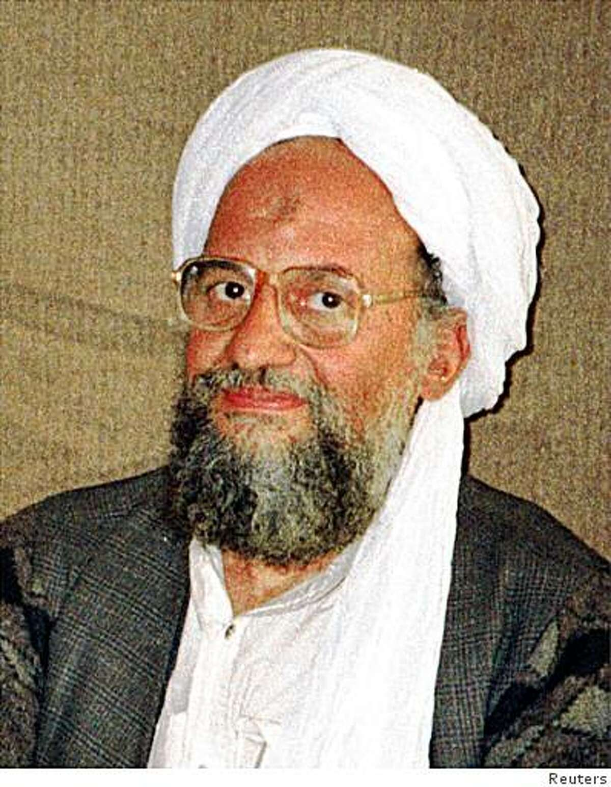 Al Qaeda's top strategist and second-in-command Ayman al-Zawahri is shown in this undated file photo. A U.S. airstrike in Pakistan targeted al Qaeda's No. 2 al-Zawahiri but it was unclear if he had been killed, CNN quoted U.S. sources as saying on January 13, 2006. Al Qaeda leader Osama Bin Laden and the Egyptian-born Zawahiri have eluded capture since U.S.-led forces toppled Afghanistan's Taliban government in 2001 after the September 11 attacks. PAKISTAN OUT REUTERS/Hamid Mir/Editor/Ausaf Newspaper for Daily Dawn/Files