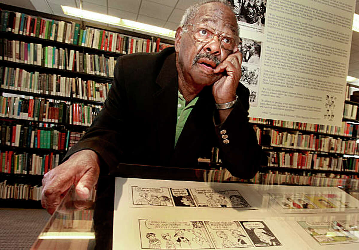 """Inside the library, Morrie Turner stood next to some of his early Wee Pals strips. Morrie Turner, the 87 year old cartoonist, who created America's first integrated strip """"Wee Pals"""" is the subject of a retrospective at the San Francisco Main Library."""
